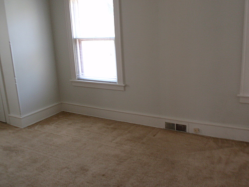 115 Bulkley second bedroom with carpet, set of double hung windows, and floor vent.